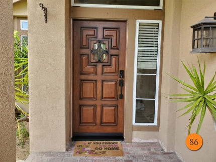 86-36x80-jeldwen-a1209-fiberglass-entry-door-knotty-alder-grain-factory-stained-chappo-seville-wrought-iron-speakeasy-installed-in-rancho-santa-margarita-ca