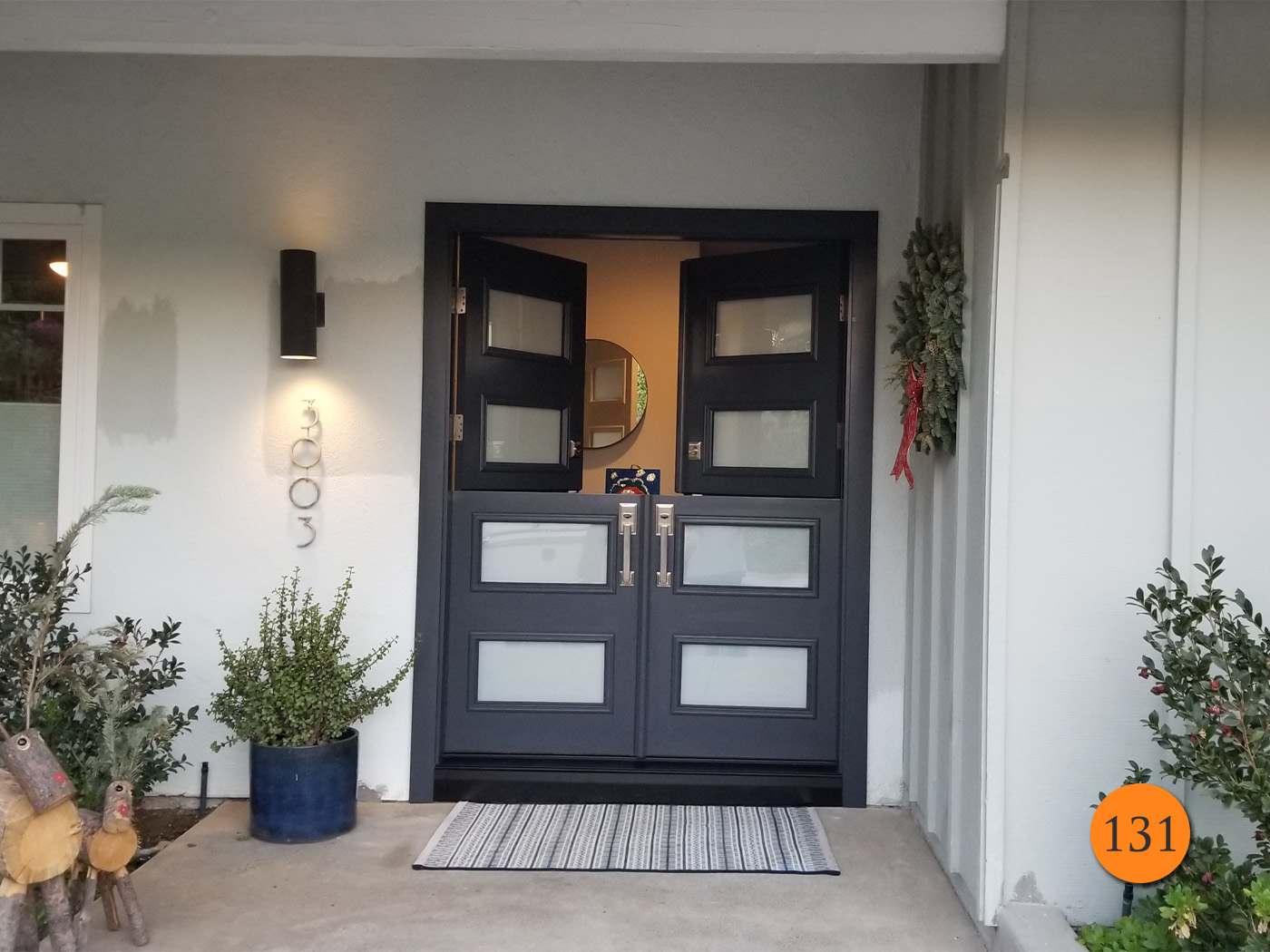 Dark grey double dutch door with frosted glass panels and brushed nickel hardware