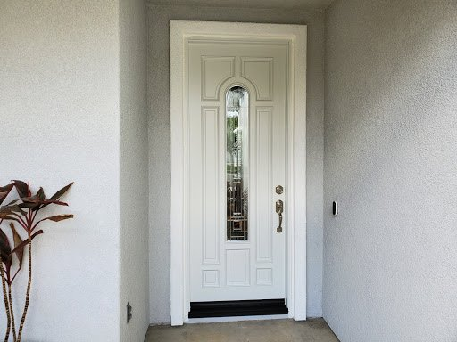 white, warm and inviting entry door with a classic style