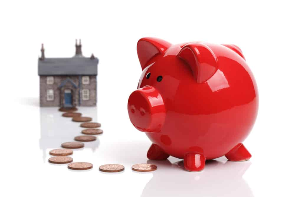piggy bank with trail of coins leading up to front door of customer's home