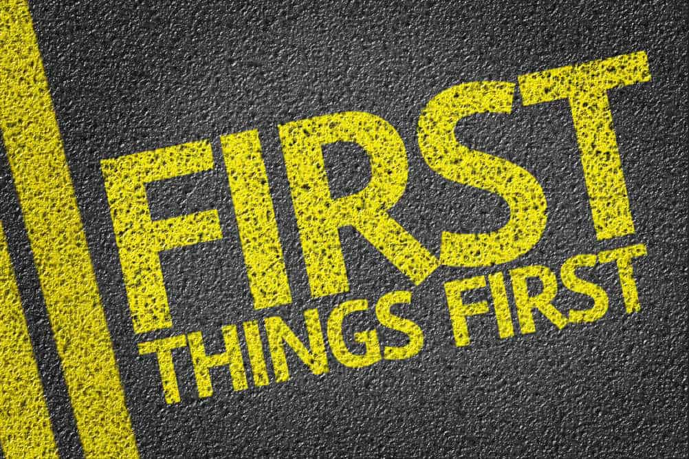 first things first painted in yellow on the asphalt