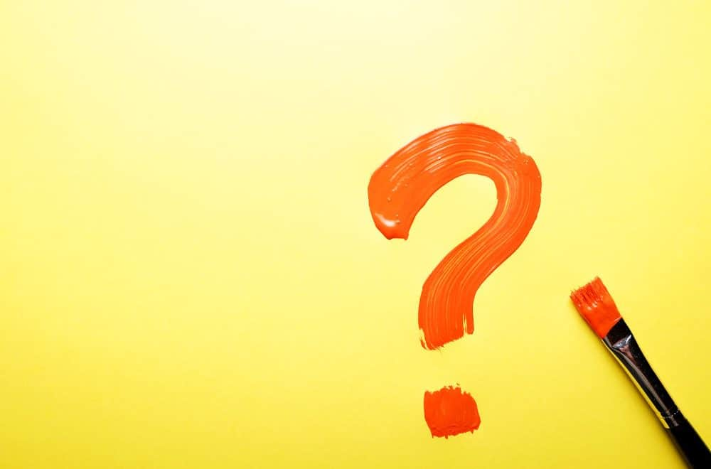 red question mark painted on red background